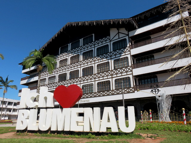 "The timber framing style Blumenau city hall with the ""Ich s2 Blumenau"" sign in front of it."