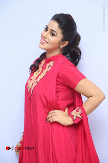 Actress Poorna Latest Stills in Red Dress at Rakshasi First Look Launch  0067.JPG