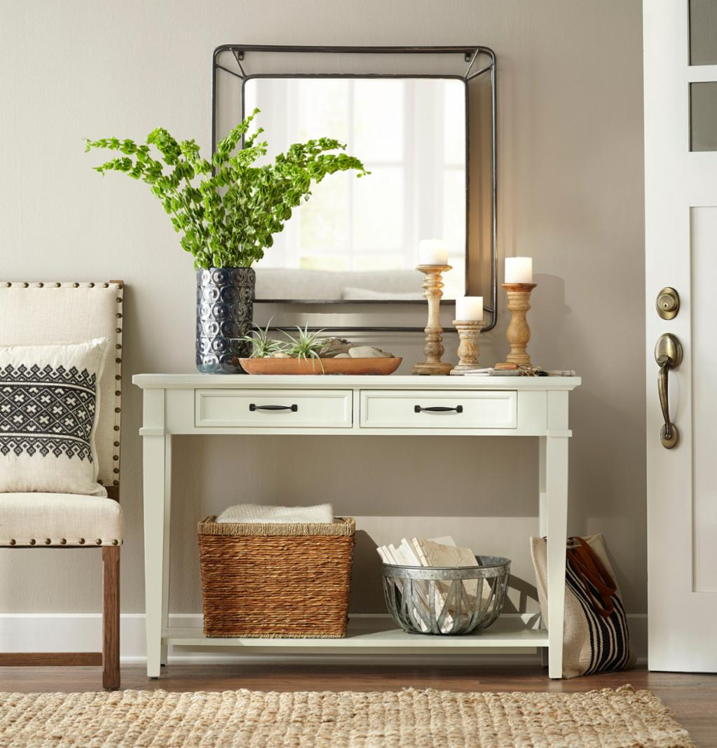 entry decorated with white table, chair, natural rug, and more from The Home Depot