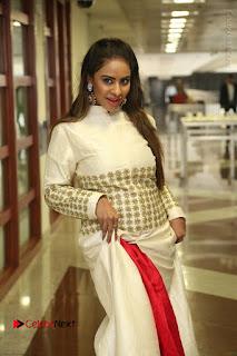 Telugu Actress Sri Reddy Mallidi Stills in White Beautiful Dress at Marriage Needs Bridal Fashion Week 2017 Logo Launch  0008.JPG
