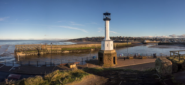 Photo of Maryport Lighthouse with the town in the background