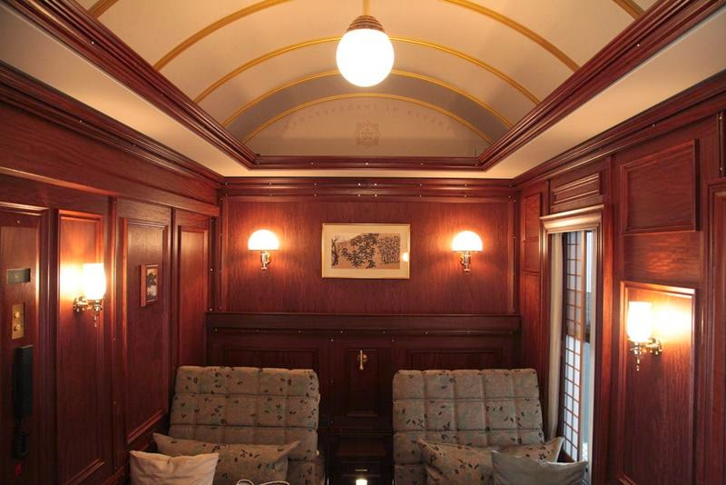 The rear of the lounge car also features a large window for enjoying the scenery as it flows by.