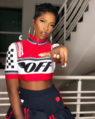 Tiwa Savage flaunts Abs