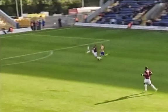 Northampton's Mathias Kouo-Doumbé miscues his clearance to score an own goal against Mansfield