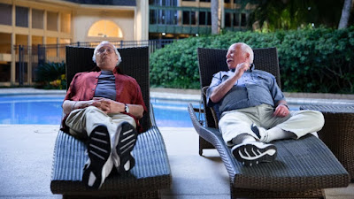 The Last Laugh 2019 Netflix Chevy Chase Richard Dreyfuss lounging by a pool