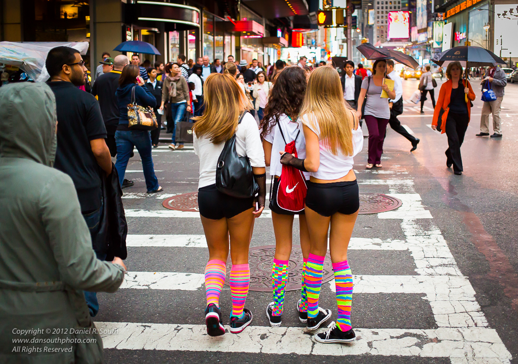 a photo of girls in hot pants and bright socks near times square