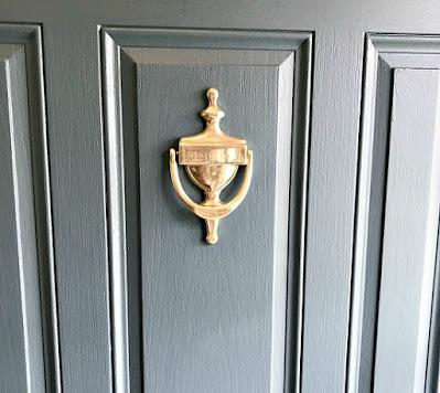 Painted front door with brass knocker