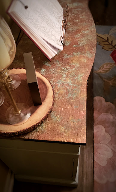 textured applied to top of buffet using a crocodile roller and copper with patina