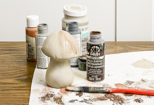 Painting Dollar Tree ceramic mushrooms to look like concrete