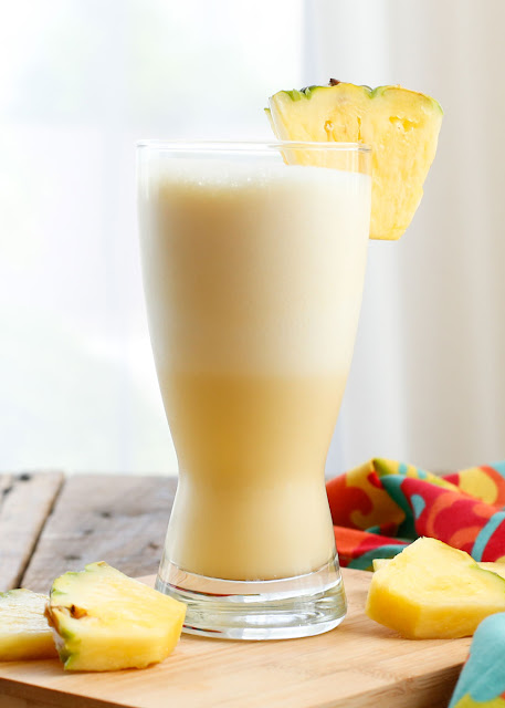 This Pineapple Orange Julius is a tropical twist on the classic Orange Julius drink and best of all you can make at home! - get the recipe at barefeetinthekitchen.com