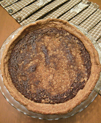 Shoo Fly Pie, molasses and streusel crumbs baked into a delicious pie.