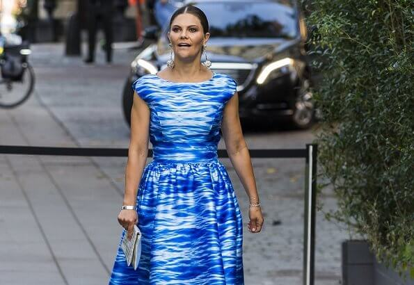 Crown Princess Victoria wore a Camilla Thulin sea blue print dress, Anya Hindmarch metallic clutch