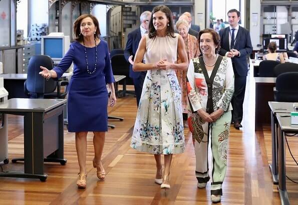 Queen Letizia wore Adolfo Dominguez floral print dress and Hugo Boss silk blouse, and Steve Madden pumps