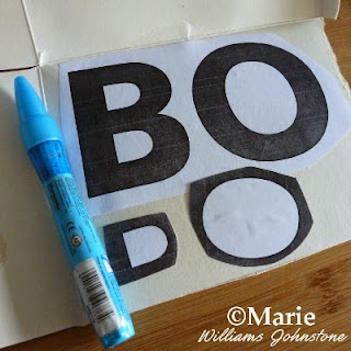 Printed BOO letters stuck onto cardboard backing with a Zig glue pen