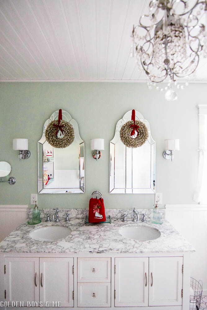 Christmas decor in master bathroom with carrera marble