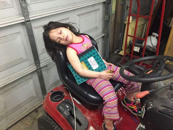 15+ Hilarious Pics That Prove Kids Can Sleep Anywhere - Napping On The Riding Lawn Mover. Amazing That She Can Still Hold On To Her Book And Crayons