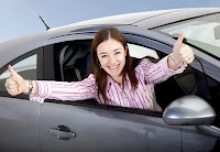 Woman happy in her car
