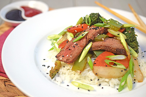 Recipe for flank steak and broccoli stir fry on a kamado grill