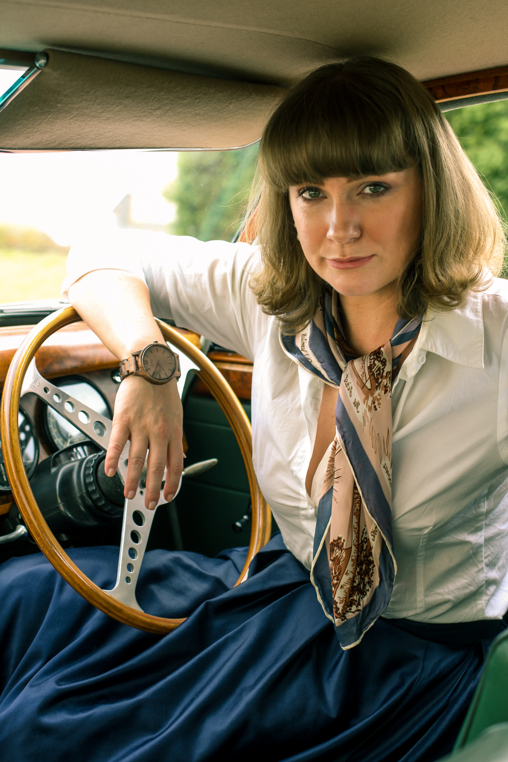 Liana of @findingfemme wears a JORD Wood Watch in her Jaguar Mark II.