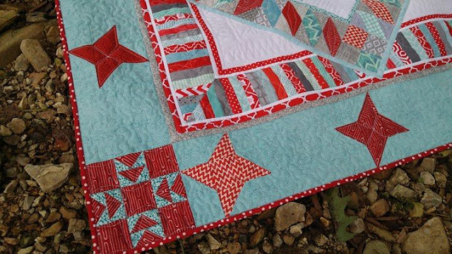 Red and aqua string star round robin quilt