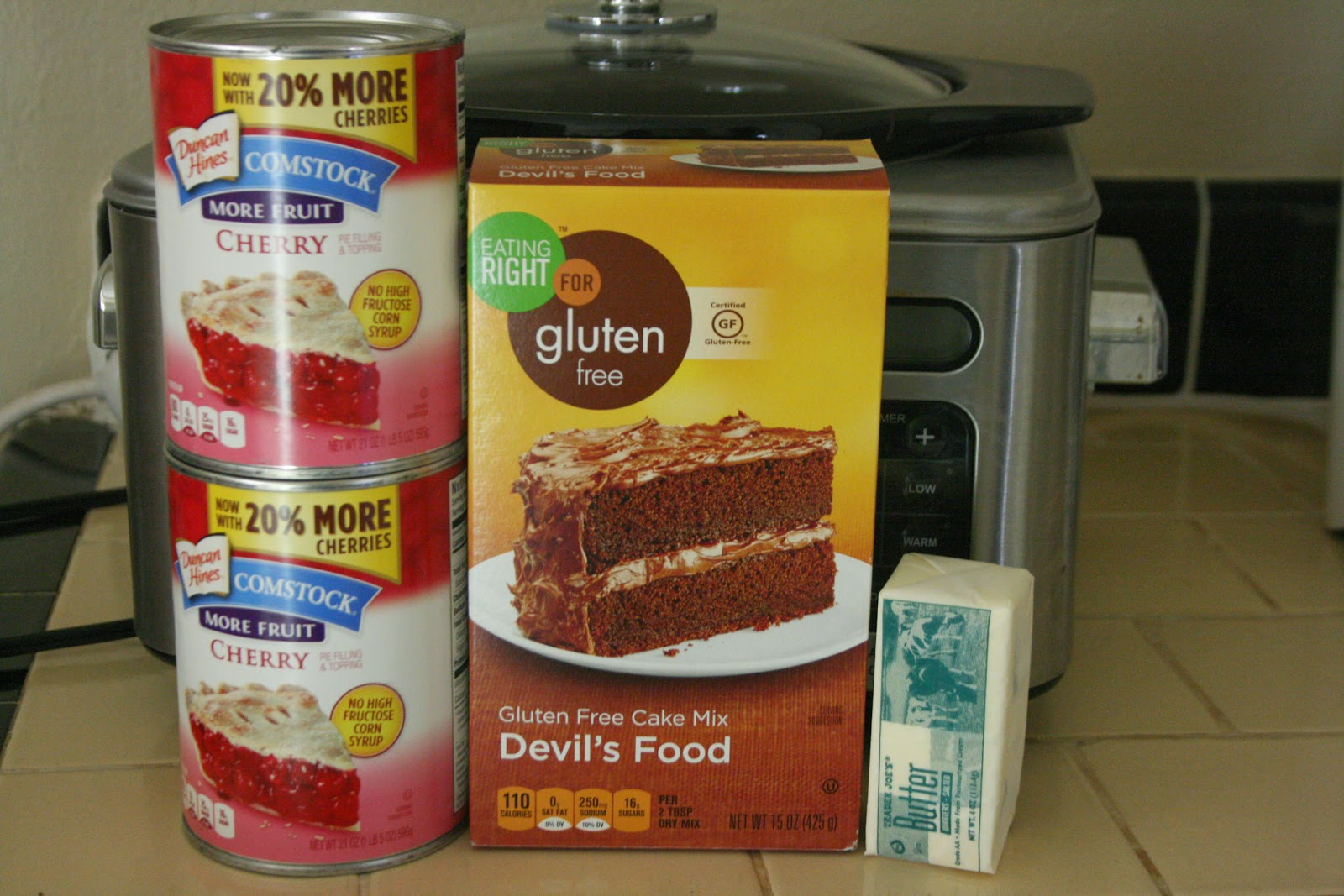 3 Ingredient Slow Cooker Dump Cake -- you can use your own favorite boxed mix with any kind of pie filling. Easy and delicious!