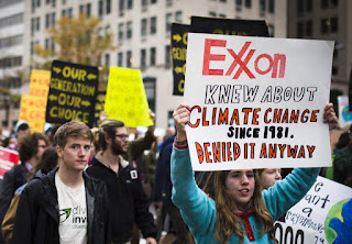 Exxon Knew march (Photo Credit: Johnny Silvercloud via Flickr CC BY-SA 2.0) Click to Enlarge.