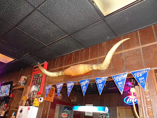 appropriate decor for Cattlemen's Lounge in Dodge City