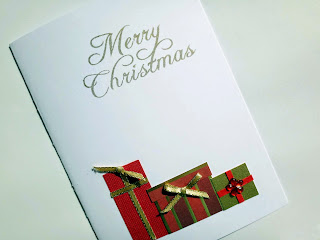 Hand made Christmas card with gifts and stamped greeting