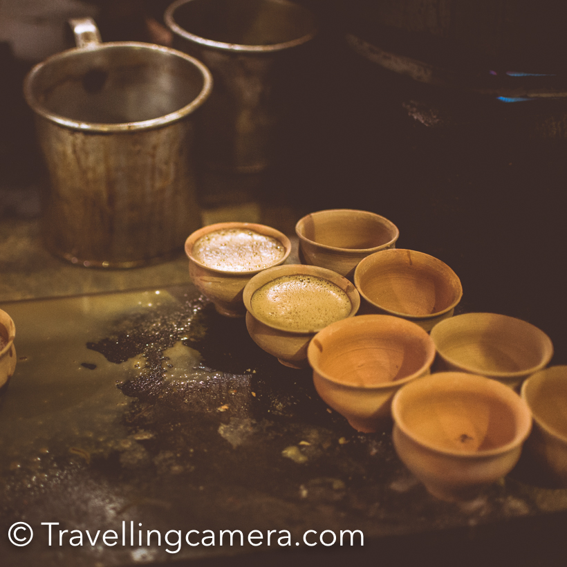 When we were in Kolkata Sohail from 'The Beacon' took us on Night tour of the city and ourfirst stop was Kolkata's famous Doodh-Fanta. The name is not thatexciting but both  Vibha and I were excited to try new thing in thecity. This post shares more about Doodh(Milk)-Fanta of Kolkata.From Bikers Cafe,we drove to Balwant Singh Dhaba, Bhawanipur. It was around 10:30pm andthere was huge queue of cars outside the dhaba. There were lot of folkson the road who were taking order. While sitting in the car, we alsoordered a Doodh-Fanta. After few minutes, we were given a jug of Doodh-Fanta and few bhats (earthen cups). Sohail served us the drink in Kulhad(bhat) . After first sip, I realized that it is very different than what I imagined. A cold mild with a very different flavor and in orange color. Definitely Fanta was not the prominent flavor, which I liked. Milk has subtle fruity taste with very nice flavor. It seems, no one knowns the recipe. I would say that drink was not very impressive. It's not like I would crave for it, but it's not bad at all. A nice drink and probably you would fall in love if you drink it more often. It takes time to develop taste for any drink. After having 3 cups of Doodh-Fanta, we went out to check the place and they were also selling tea. There were lot of people around the counter to get token for tea. I loved the environment around this street - lot of cars parked and people enjoying Doodh-Fanta and services in car. Few discussions about Doodh-Fanta on Facebook - Later on Sohail told us about 7 such places in Kolkata where you get a very different experience of food/drinks. Check out their link to know more about '7 places in Kolkata where you will find the quirkiest foods'.
