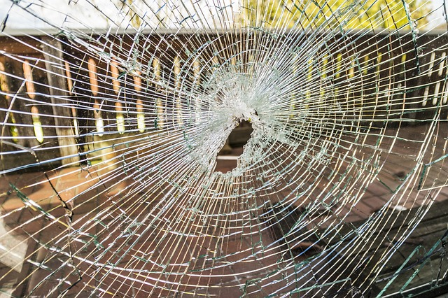 Glass cracked like a spider web with hold in the center