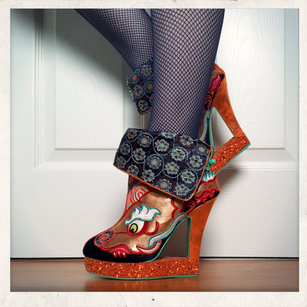 wearing irregular choice tatsu cut out dragon wedge boots