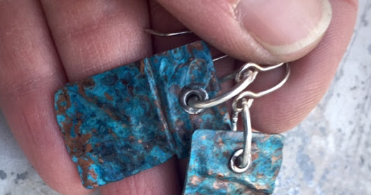 Fold formed copper earrings with a blue patina
