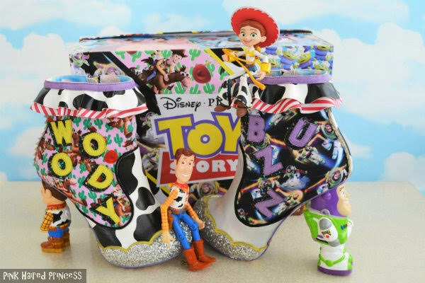 pair of Toy Story boots sitting in front of shoe box with Jessie and Woody cowgirl and boy small toys sitting on the boots