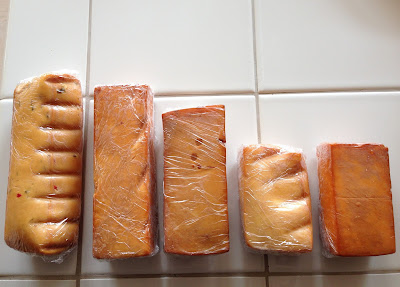 Smoked cheese wrapped and ready for refrigeration: (L-R) pepper jack, extra sharp cheddar, Gouda, Monterey Jack, sharp cheddar