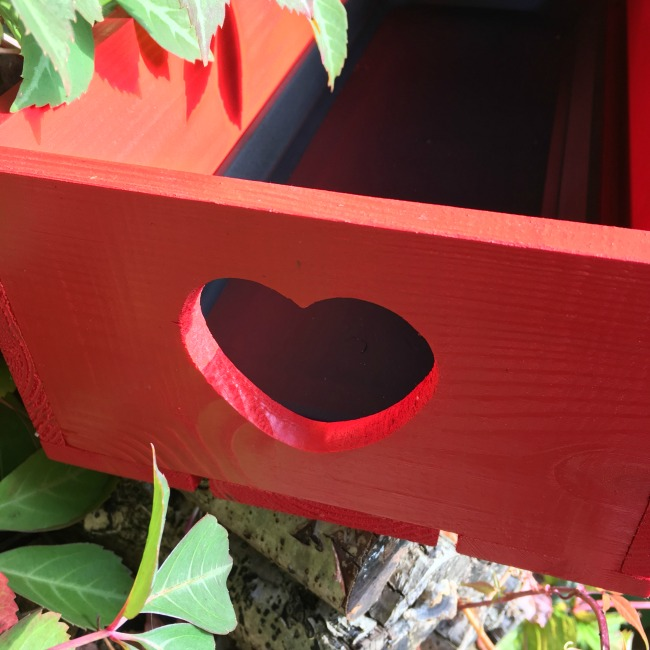 Plantabox-personalised-wooden-apple-crate-image-of-empty-red-table-centrepiece-heart-shaped-cutout-handle