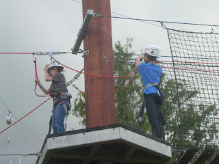 Wil and Sam on a platform of the ropes course