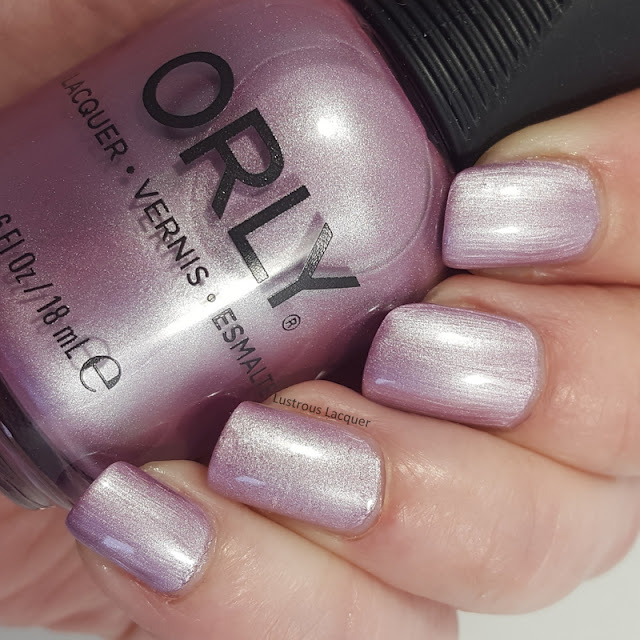 Icy Pink nail polish with a purple undertone and a pearl finish from the Pastel City Collection