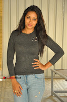 Actress Bhanu Tripathri Pos in Ripped Jeans at Iddari Madhya 18 Movie Pressmeet  0058.JPG