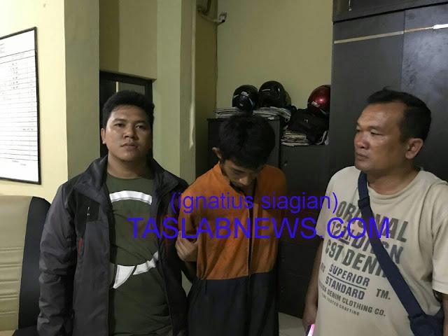 Tersangka Khairul Azhari Panjaitan saat diamankan di ruang tahanan Sat Res Narkoba Polres Tanjungbalai, Selasa (25/9).