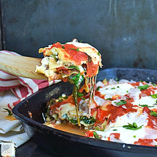 Cheesy Skillet Lasagna | by Life Tastes Good is so much easier to make than traditional lasagna, and it has all the same great tastes! I love all the fresh ingredients in this easy skillet lasagna. It is loaded with 3 different types of cheese, fresh tomatoes, spinach, and herbs for a satisfying meal the whole family will love!