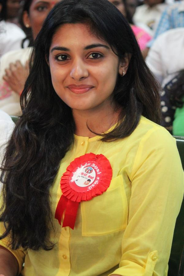 Glamorous Malayalam Actress Niveda Thomas Photos In Yellow Dress