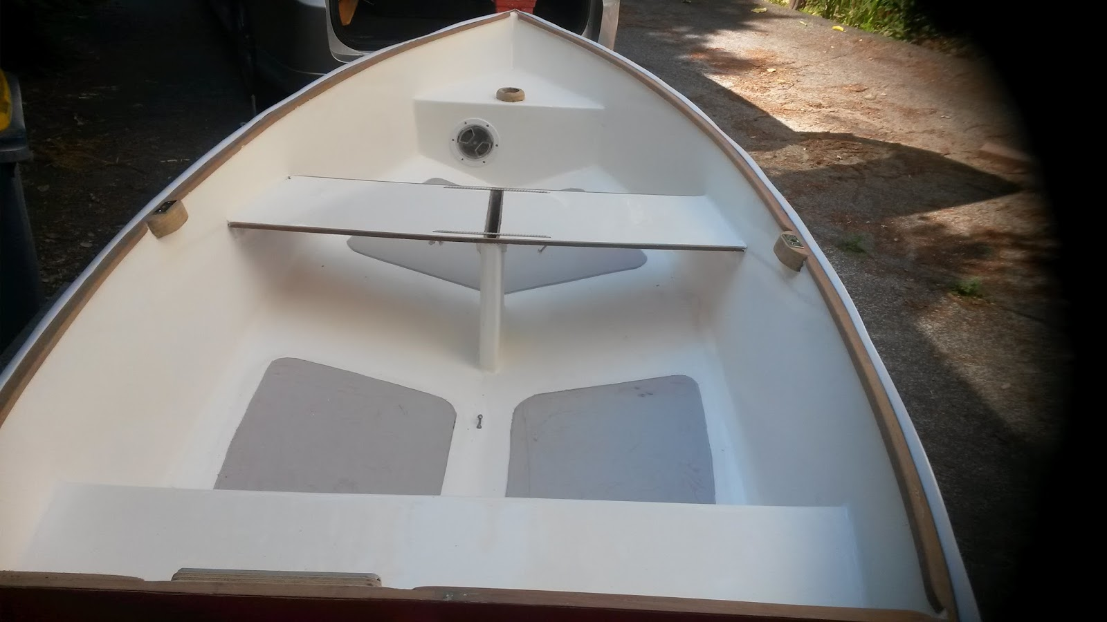 Interior view of finished boat, with wood rubrail and rubber bumper.