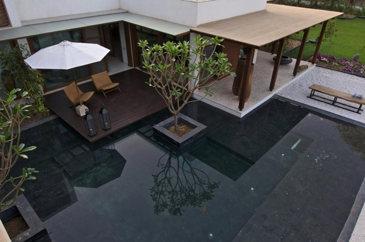 Pond and terraces in Courtyard Home by Hiren Patel Architects
