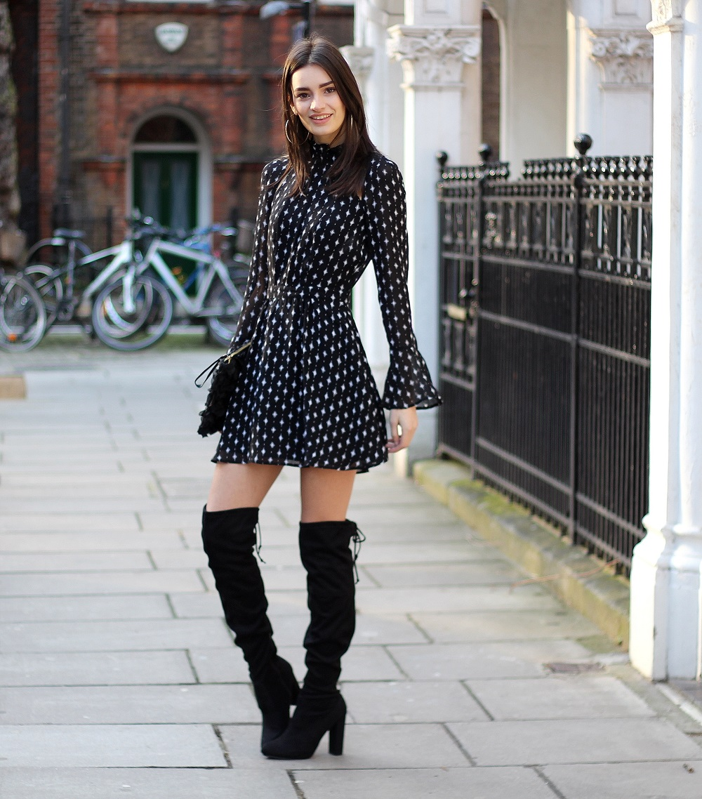 peexo wearing skater dress and knee high boots