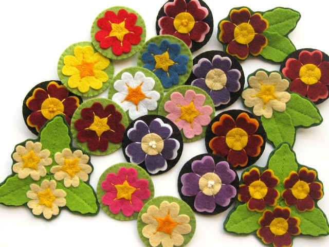 Lots of spring felt flower brooches