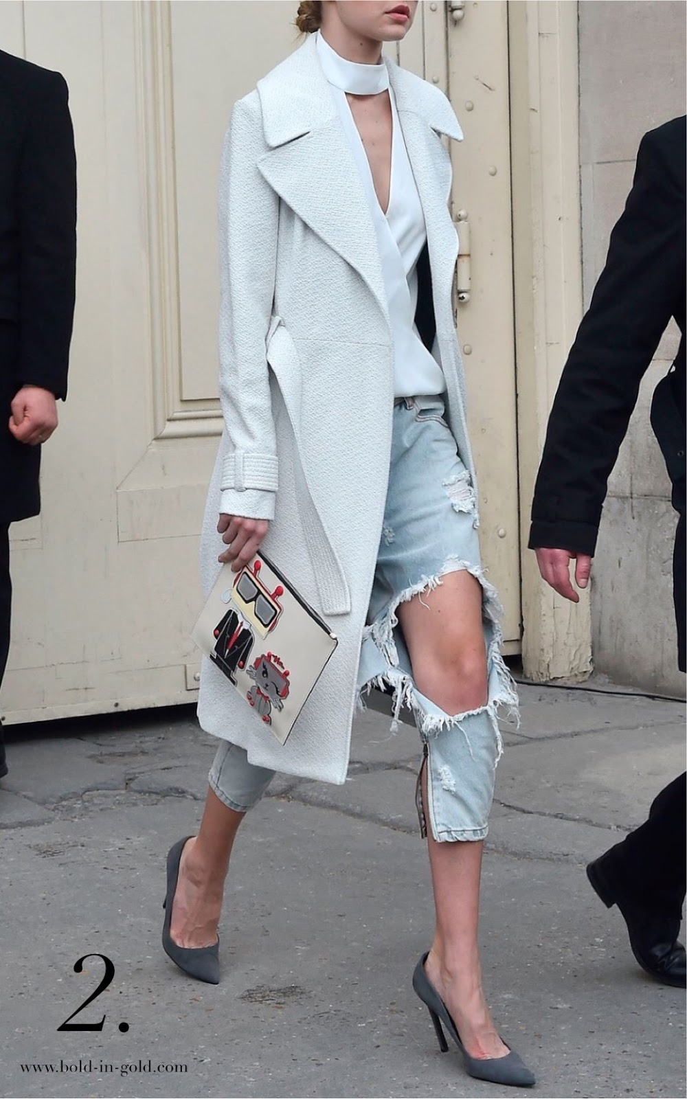 Woman wearing ripped jeans with flowing white coat