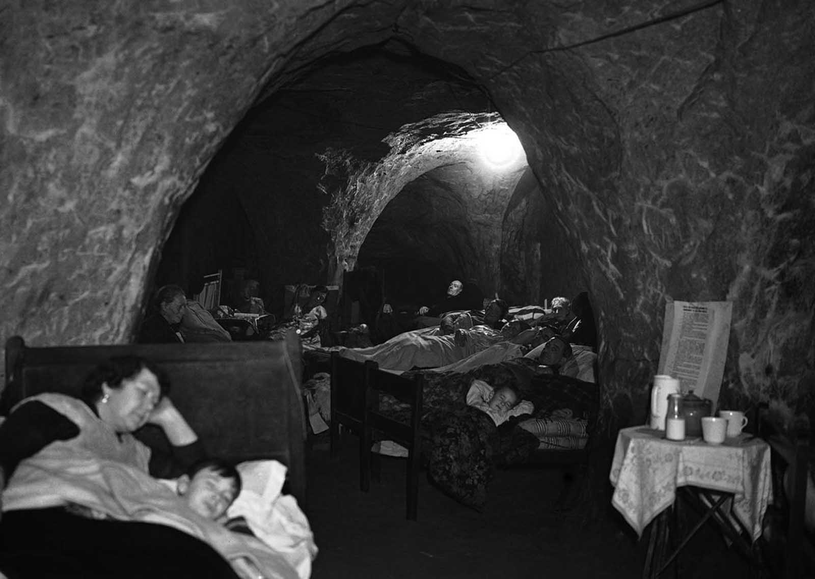 Hundreds of people, many of whom have lost their homes through bombing, now use the caves in Hastings, a south-east English town as their nightly refuge. Special sections are reserved for games and recreation, and several people have