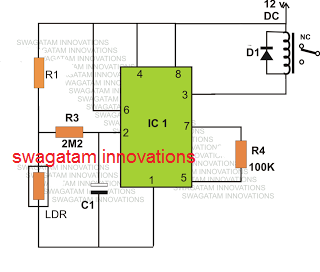 IC 555 based day night triggered relay switch circuit