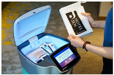 Source: Hotel Jen. Jeno makes a delivery. The top of the robot automatically opens to show its contents at the right time, and will close by itself after the guest has given feedback on its performance.