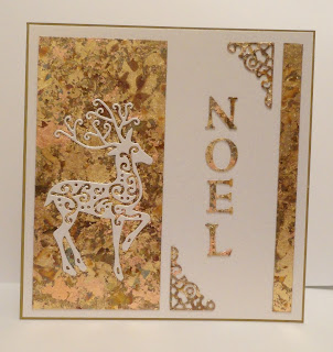 Gold gilded Christmas card with reindeer and Noel